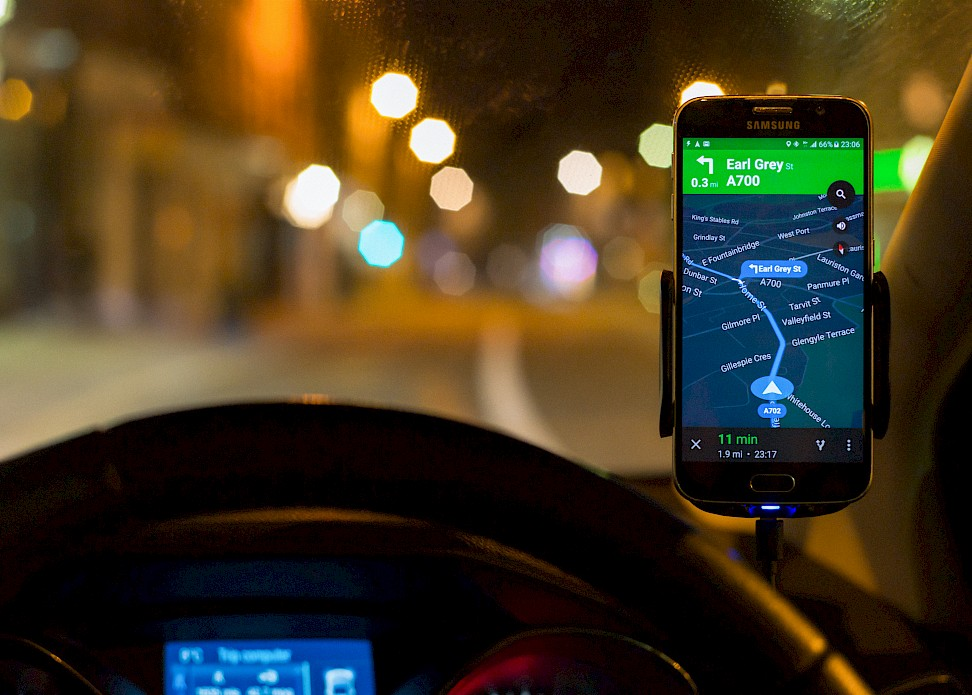 Smartphone with navigation app open in car